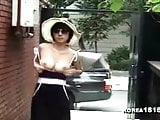 Sexy Korean MILF shows off in public