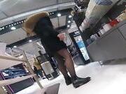 Candid teen in black pantyhose shoping