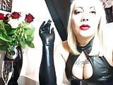 Smoking Blonde With Red Lipstick in Latex Gloves