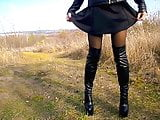 High boots, nylon tights and a short dress