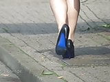 Secretary with stunning legs and heels is rushing for the bu