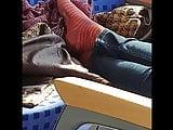 Striped red worn socks in a train