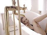 Hot Petite Blonde teasing in a luxury studio