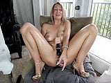 Butt plugged blonde MILF fucking her wet bald pussy