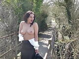 A British MILF walks in the sunshine, then takes a piss