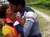 cute force kiss in park