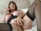 Busty Mature in Stockings Performs