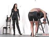 English dominatrix whips handcuffed slave
