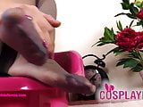 Supergirl cosplayer takes off boots and shows nylon feet
