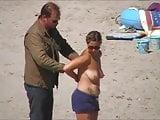 German milf on french beach spy. Shaky quality.