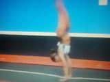 RedBone Ebony doing backflips in string blue thongs