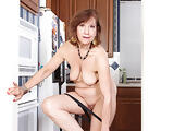 American gilf Penny gets busy in the kitchen