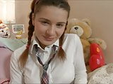 Cute schoolgirl fucks her ass with dildo