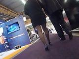 Candid mature in black pantyhose heels walking in expo